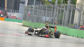 Kimi Raikkonen racing in F1 Singapore GP Stock Photography