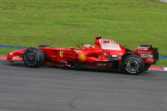 Kimi Raikkonen, Scuderia Ferrari Malboro F1 team. Kimi Raikkonen speeding up a straight at the Sepang International Circuit, Malaysia Royalty Free Stock Image