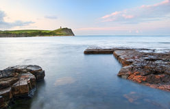 Kimmeridge海湾日出横向,多西特英国 免版税库存图片