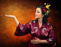 Kimono Caucasian woman extending her right arm Stock Image