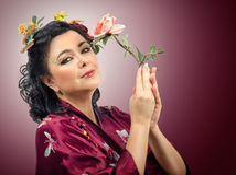 Kimono caucasian woman holding pink rose Stock Photos