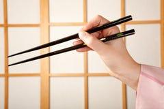 Kimono and chopsticks Royalty Free Stock Images