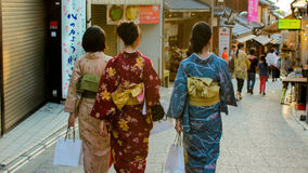 Kimono-clad Walking in Kyoto Stock Photo