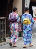 Kimono dressed girls in Kyoto, Japa. Kyoto/Japan - August 9 2018: Kimono dressed girls in Gion district in Kyoto, Japan. Gion district is one of the most royalty free stock images