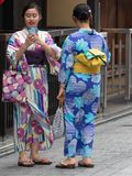Kimono dressed girls in Kyoto, Japa. Kyoto/Japan - August 9 2018: Kimono dressed girls in Gion district in Kyoto, Japan. Gion district is one of the most stock image