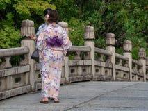 Kimono dressed girls in Kyoto, Japa. Kyoto/Japan - August 9 2018: Kimono dressed girls in Gion district in Kyoto, Japan. Gion district is one of the most royalty free stock photo