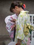 Kimono dressed girls in Kyoto, Japan. Kyoto/Japan - August 9 2018: Kimono dressed girls in Gion district in Kyoto, Japan. Gion district is one of the most stock images