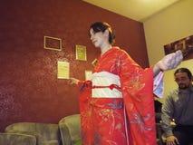 Kimono dressing demonstration Stock Images