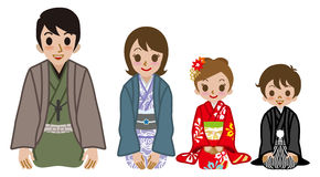 Kimono family sitting on heels Royalty Free Stock Photos