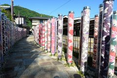 Kimono forest. Arashiyama station. Kyoto. Japan. Kimono Forest is a collection of gorgeous cylinder shaped pillars framing the lane way to Randen tram station on Royalty Free Stock Photo