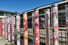 Kimono forest pillars. Arashiyama station. Kyoto. Japan. Kimono Forest is a collection of gorgeous cylinder shaped pillars framing the lane way to Randen tram Royalty Free Stock Photo