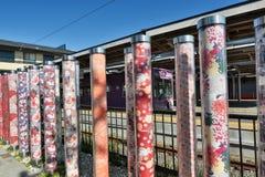 Kimono forest pillars. Arashiyama station. Kyoto. Japan. Kimono Forest is a collection of gorgeous cylinder shaped pillars framing the lane way to Randen tram Royalty Free Stock Photo