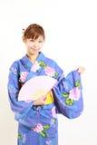Kimono giapponese con il fan di carta Immagini Stock Libere da Diritti