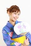 Kimono giapponese con il fan di carta Fotografia Stock