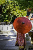Kimono Girl and Red Umbrella Stock Image