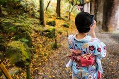 Kimono girl selfie by smartphone Stock Images