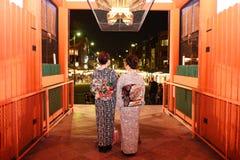 Kimono girls at Yasaka shrine gate, Kyoto Stock Photo
