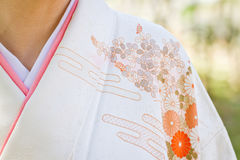 Kimono Shoulder Detail. Closeup of the shoulder and overlap of a woman`s kimono worn outdoors Royalty Free Stock Image