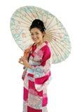 Kimono and Umbrella Girl. Asian girl in a traditional kimono with umbrella isolated on white Stock Photos