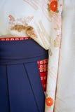 Kimono Waist Closeup. Detail of a woman`s kimono with obi sash and hakama overskirt stock photography