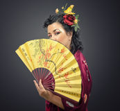 Kimono white woman holding traditional fan Stock Image