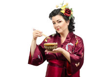 Kimono woman eating from a bowl with chopsticks Stock Photography