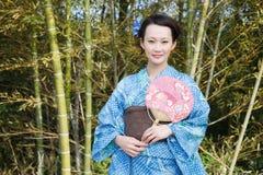 Kimono woman with fan Royalty Free Stock Photo