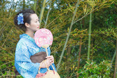 Kimono woman with fan Royalty Free Stock Photos