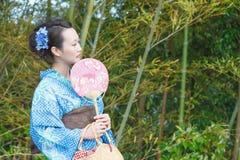 Kimono woman with fan Royalty Free Stock Photos