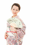 Kimono woman with fan Royalty Free Stock Photo