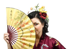 Kimono woman hiding her face behind a fan Royalty Free Stock Photography