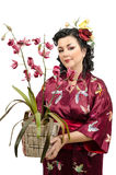 Kimono woman holding wicker pot of orchid Royalty Free Stock Image