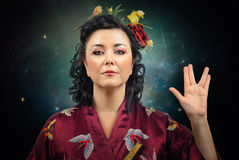 Kimono woman showing Spoke sign Royalty Free Stock Photos