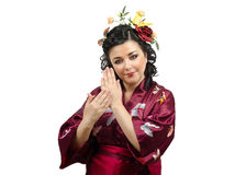 Kimono woman showing traditional gestures Royalty Free Stock Photos