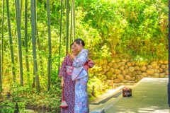 Kimono women in Bamboo Forest Royalty Free Stock Images