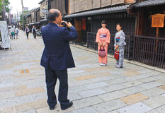 Kimonos in Gion, Kyoto. Two Japanese women in traditional kimono have their photo taken in the district of Gion in Kyoto. Gion is Kyoto`s most famous geisha Royalty Free Stock Image