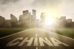 Kina ord på vägen med soluppgång Royaltyfri Fotografi