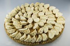 Kina traditionell mat -- Kokta klimpar Fotografering för Bildbyråer
