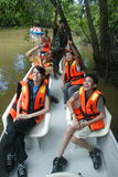 Kinabatangan River Safari. Tourists enjoy a wonderful travel discovery through the beautiful scenery of the Mangrove Forest Kinabatangan River, Sabah, Malaysia Royalty Free Stock Photos