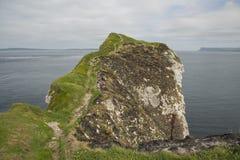 Kinbane head antrim north ireland. Kinbane head with fair head and rathlin ireland in background Royalty Free Stock Image