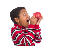 Kind überraschte öffnende Apple-Tür Stockfotografie