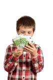 Kind achter geld wordt verborgen dat Stock Afbeeldingen