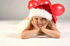 Kind als kleiner Weihnachtsmann Lizenzfreies Stockfoto