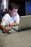 Kind auf Computer Lizenzfreies Stockfoto