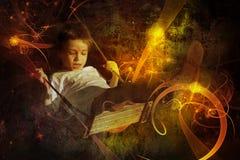 Kind auf einem Schwingen Stockfoto