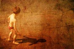 Kind auf einem Strand Stockfotos
