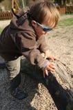 Kind auf Kabel Stockfotos
