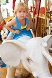 Kind auf Karussell Lizenzfreies Stockbild