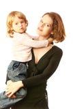 Kind auf Mutterhänden Stockfoto