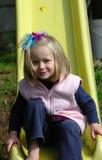 Kind auf Plättchen Stockbild